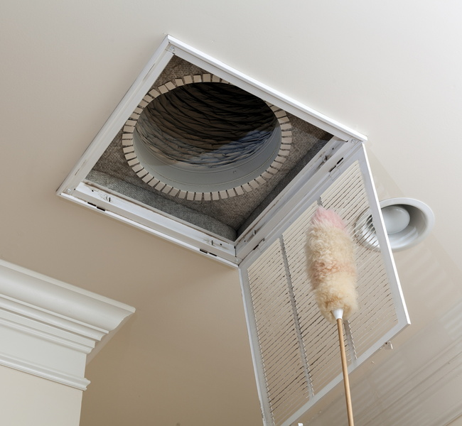 duct-with-cleaning-brush-held-beneath-it