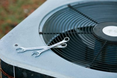 air-conditioner-outside-unit-with-tools-on-top