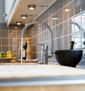 kitchen-faucet-with-water-coming-out