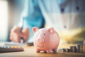 piggy-bank-with-coins-surrounding-it