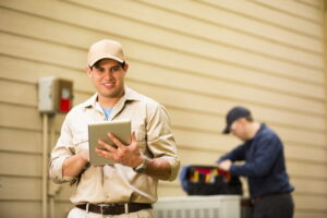 two-technicians-working-outdoor-ac-unit