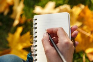 hand-writing-in-notebook